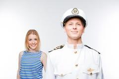Il capitano e la donna Immagine Stock
