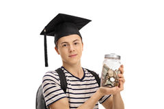 Il cappello di graduazione dell'adolescente ed il barattolo d'uso di tenuta hanno riempito di mone Immagine Stock Libera da Diritti
