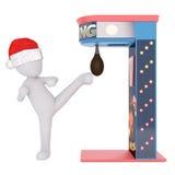Il cappello di Santa che indossa la figura 3D dà dei calci al punching ball Immagini Stock