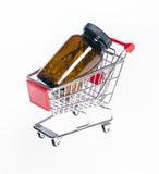 Il carrello del prodotto con un barattolo con le capsule Fotografia Stock