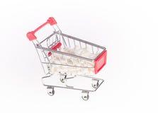 Il carretto del prodotto con le capsule Immagini Stock Libere da Diritti