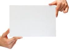 Il cartone in bianco dentro equipaggia le mani fotografia stock libera da diritti