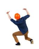 Il casco protettivo posteriore della costruzione dell'uomo di affari di vista protegge la h Fotografie Stock Libere da Diritti