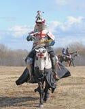Il cavaliere su a cavallo fotografia stock