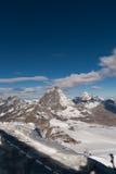Il Cervino ha coperto di nuvole un chiaro giorno dopo l'autunno in autunno, Valais della neve Immagini Stock