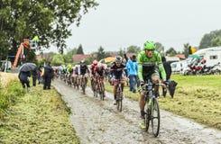 Il ciclista Lars Boom su una strada Cobbled - Tour de France 2014 Immagini Stock