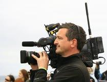 Il cineoperatore filma gli eventi a John O'Groats, Scozia Fotografie Stock