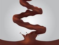 Il cioccolato al latte e la crema/latte di versamento spruzzano Fotografie Stock