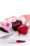 Il cioccolato di figura del cuore con è aumentato Fotografie Stock
