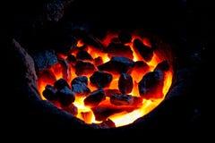 Il cole di pietra è rosso su fuoco Fotografie Stock Libere da Diritti