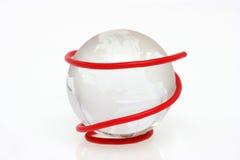 Il collegare rosso con il globo di cristallo Fotografie Stock Libere da Diritti