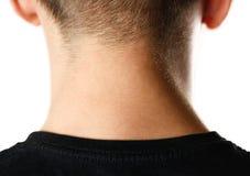 Il collo dell'uomo da dietro narcosi Fine in su Isolato su priorità bassa bianca immagine stock libera da diritti
