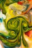 Il colore di alimento sul fondo dell'estratto del latte, marmo gradisce Fotografia Stock
