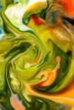 Il colore di alimento sul fondo dell'estratto del latte, marmo gradisce Fotografie Stock Libere da Diritti