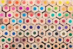 Il colore di legno stabilito disegna a matita il fondo Fotografie Stock