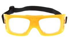 Il colore giallo protegge gli occhiali di protezione dell'occhio con priorità bassa bianca fotografia stock