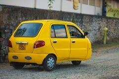 Il colore giallo tre di Ceygra spinge la parte posteriore rara dell'automobile Fotografia Stock Libera da Diritti