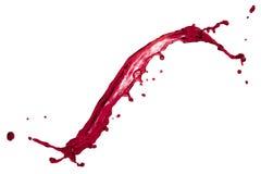 Il colore rosso della bella spruzzata liquida ha isolato su fondo bianco a Immagini Stock