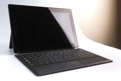 Il computer portatile isolato della compressa fotografie stock libere da diritti