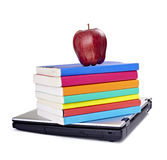 Il computer portatile prenota la mela Fotografia Stock