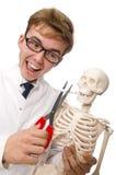 Il concetto contro il fumo con l'uomo e lo scheletro Fotografie Stock