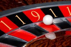 Il concetto dei numeri fortunati delle roulette del casinò spinge sec nera e rossa Immagini Stock