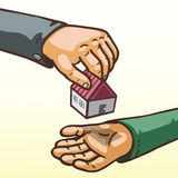 Il concetto del bene immobile passa dare e la ricezione del giocattolo della casa Fotografie Stock