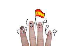 Il concetto del dito incoraggia sul gruppo che il calcio con sostiene la bandiera Spagna Immagini Stock Libere da Diritti