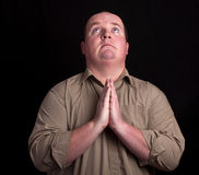 Il concetto del peso eccessivo fa lo sguardo di preghiera in su immagine stock libera da diritti