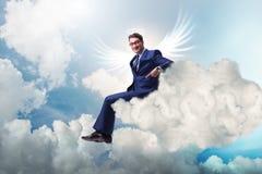 Il concetto dell'investitore di angelo con l'uomo d'affari con le ali immagine stock libera da diritti