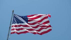 Il concetto delle relazioni/conflitto fra il Venezuela e gli Stati Uniti d'America ha simbolizzato le bandiere dipinte su una par stock footage