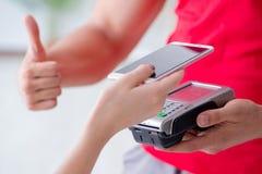 Il concetto di pagamento con il terminale di posizione Fotografia Stock Libera da Diritti