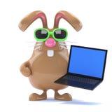il coniglietto di 3d Chcolate pasqua ha un computer portatile Immagine Stock