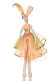 Il coniglio Handmade della bambola si è vestito in un vestito arancione Fotografie Stock Libere da Diritti