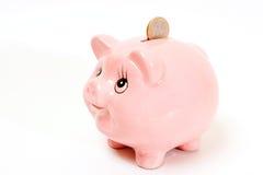 Il contenitore di soldi dentellare del maiale ha isolato Immagine Stock
