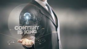 Il contenuto è re con il concetto dell'uomo d'affari dell'ologramma della lampadina illustrazione vettoriale