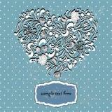 Il contorno di cuore ha presentato su un fondo blu Immagini Stock