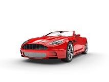Il convertibile rosso mette in mostra lo studio automobilistico sparato - vista frontale immagine stock