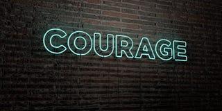 Il CORAGGIO - insegna al neon realistica sul fondo del muro di mattoni - 3D ha reso l'immagine di riserva libera della sovranità illustrazione di stock