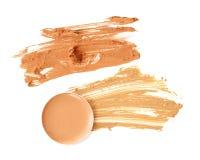 Il cosmetico compone l'isolato beige dell'insieme di colori Fotografie Stock