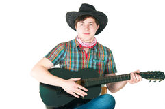 Il cowboy con una chitarra Immagini Stock
