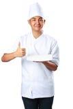 Il cuoco dei giovani tiene un piatto vuoto con il pollice su fotografia stock