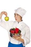 Il cuoco tiene il pepe. studio Immagine Stock