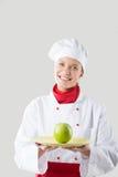 Il cuoco unico passa la mela della tenuta Fotografia Stock Libera da Diritti