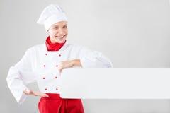 Il cuoco unico passa la tenuta dell'insegna bianca Immagine Stock Libera da Diritti