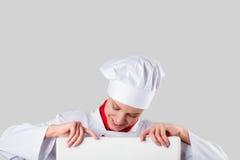 Il cuoco unico passa la tenuta dell'insegna bianca Fotografia Stock