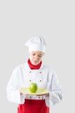Il cuoco unico passa la tenuta della mela Fotografia Stock Libera da Diritti