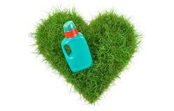 Il cuore modella l'erba con fertilizzante fotografie stock libere da diritti