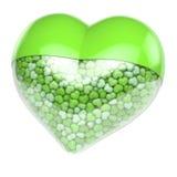 Il cuore verde ha modellato la pillola, capsula riempita di piccoli cuori minuscoli come medicina Immagini Stock Libere da Diritti