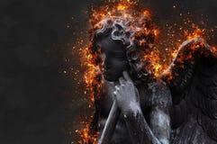 Il cupido brucia nell'inferno immagine stock libera da diritti